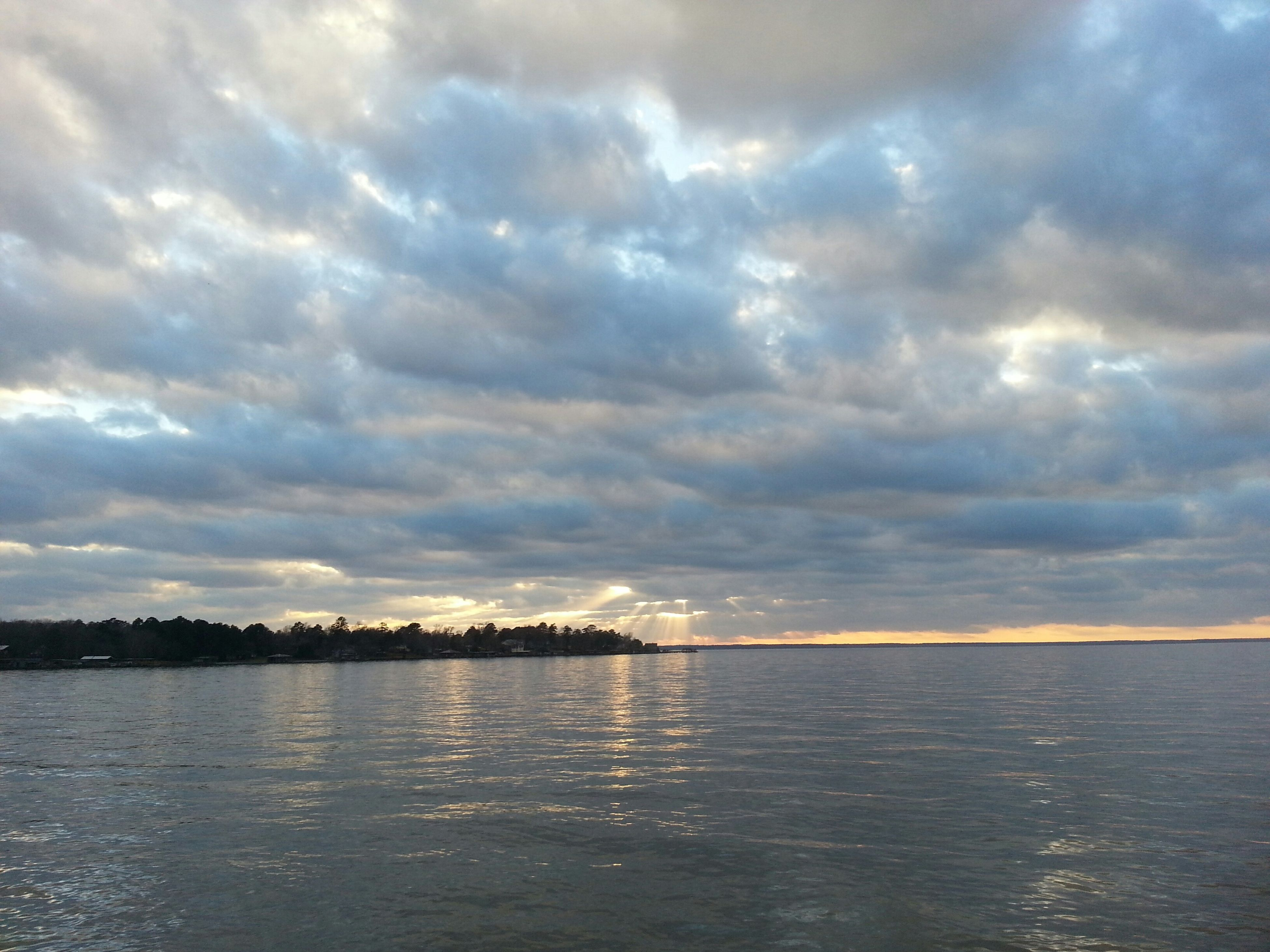 water, sky, cloud - sky, waterfront, cloudy, tranquil scene, scenics, tranquility, beauty in nature, sea, nature, weather, cloud, overcast, idyllic, sunset, reflection, rippled, lake, storm cloud