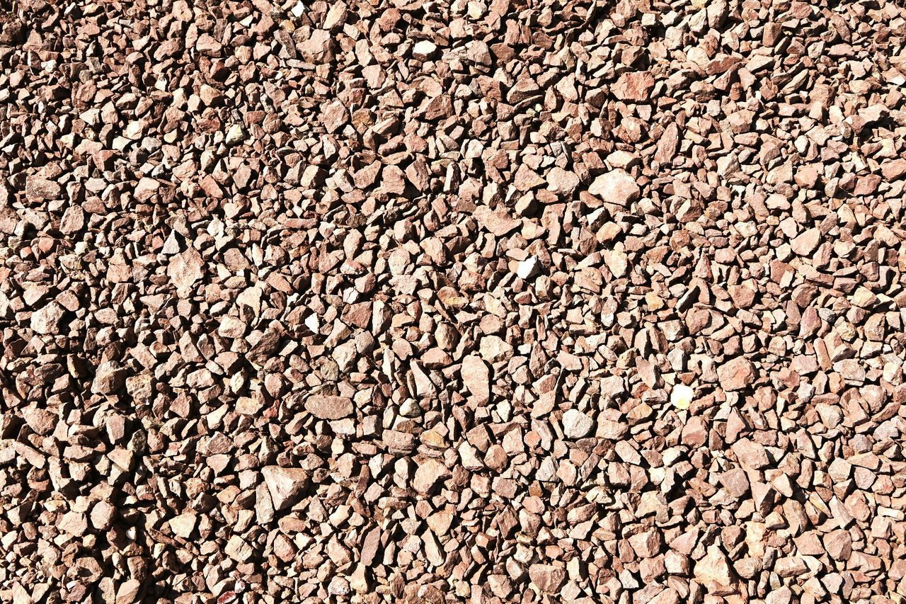 porphyry rock background. crushed stones. Rock Formation Mining Industry Mining Pit Natural Backgroud Background Porphyry Natural Background Crushed Stone Crushed Rock