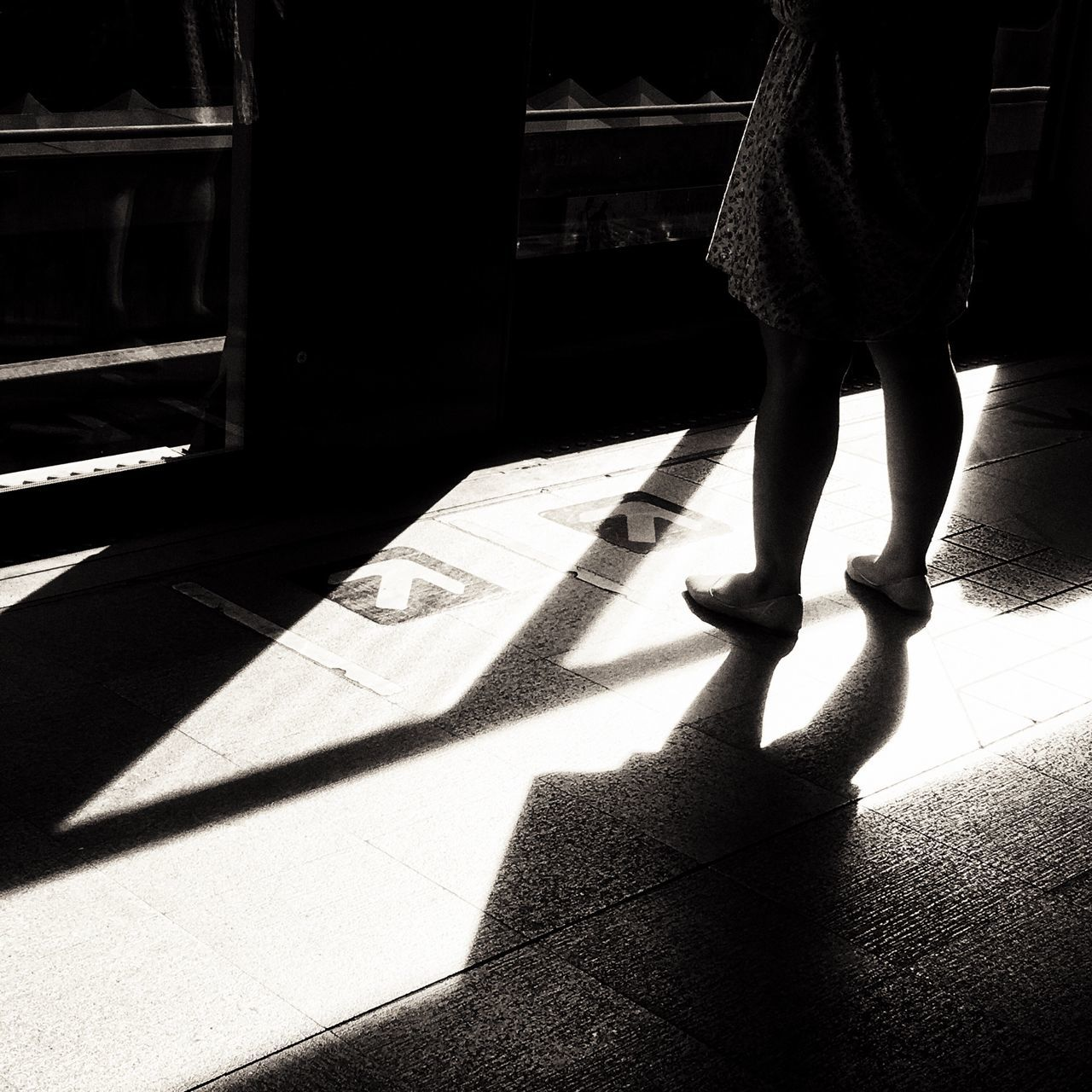shadow, sunlight, low section, human leg, real people, one person, women, indoors, day, lifestyles, human body part, young adult, adult, people