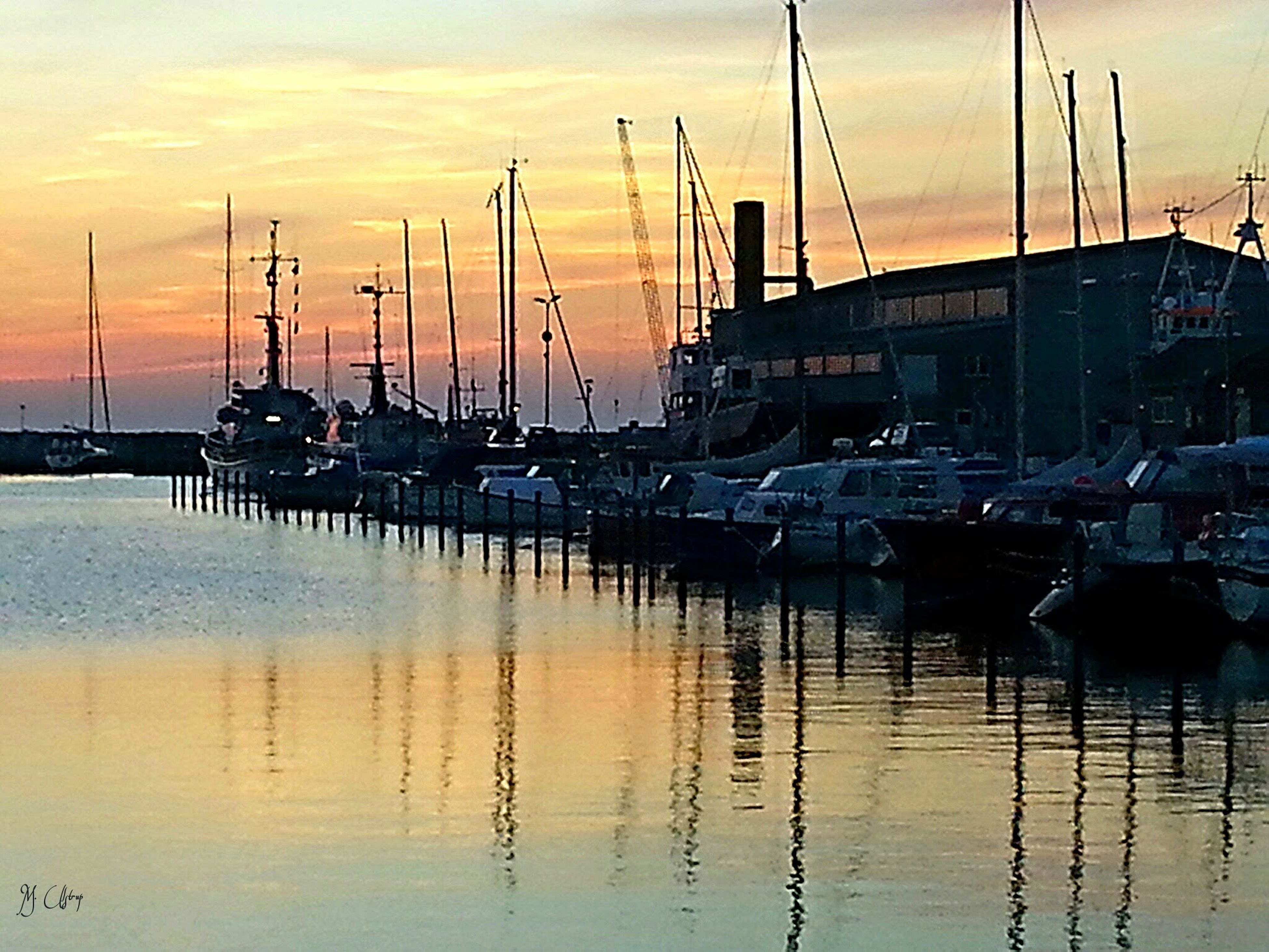 nautical vessel, transportation, sunset, moored, mode of transport, boat, water, harbor, mast, waterfront, sky, sea, sailboat, reflection, orange color, marina, commercial dock, cloud - sky, built structure, crane - construction machinery
