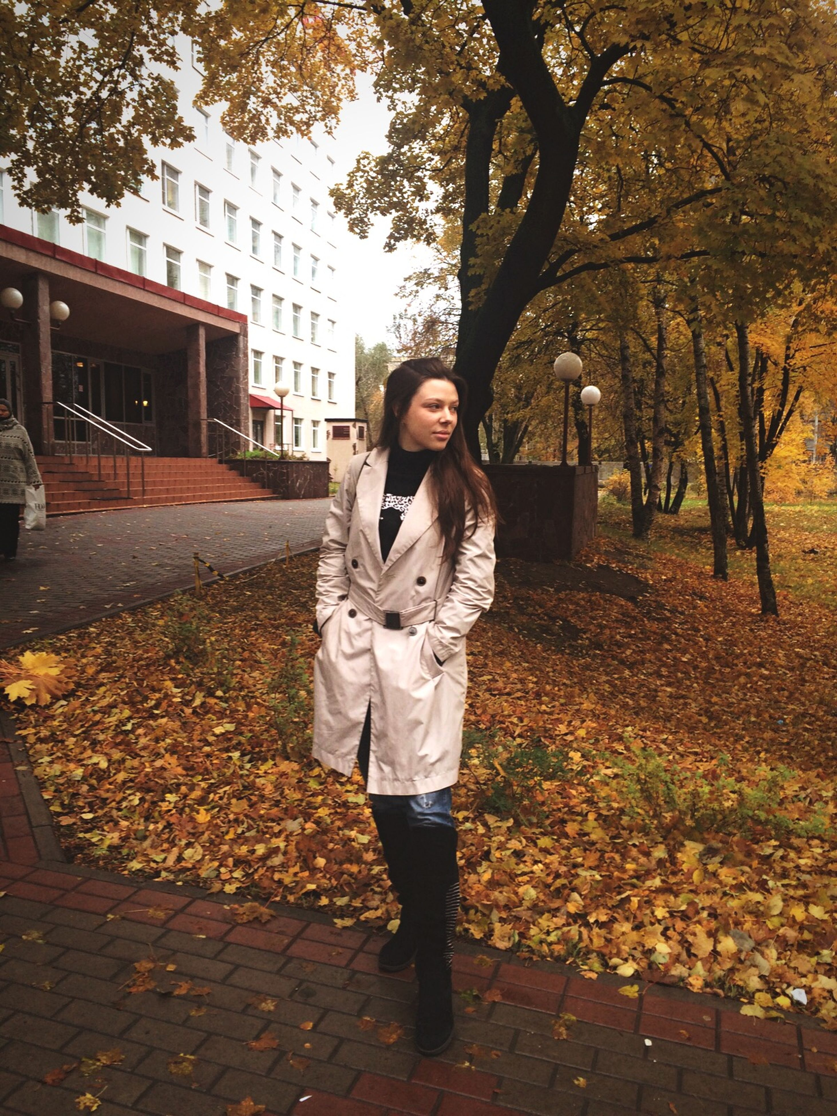 lifestyles, casual clothing, person, young adult, looking at camera, standing, front view, portrait, tree, full length, leisure activity, young women, autumn, smiling, park - man made space, day, three quarter length, outdoors