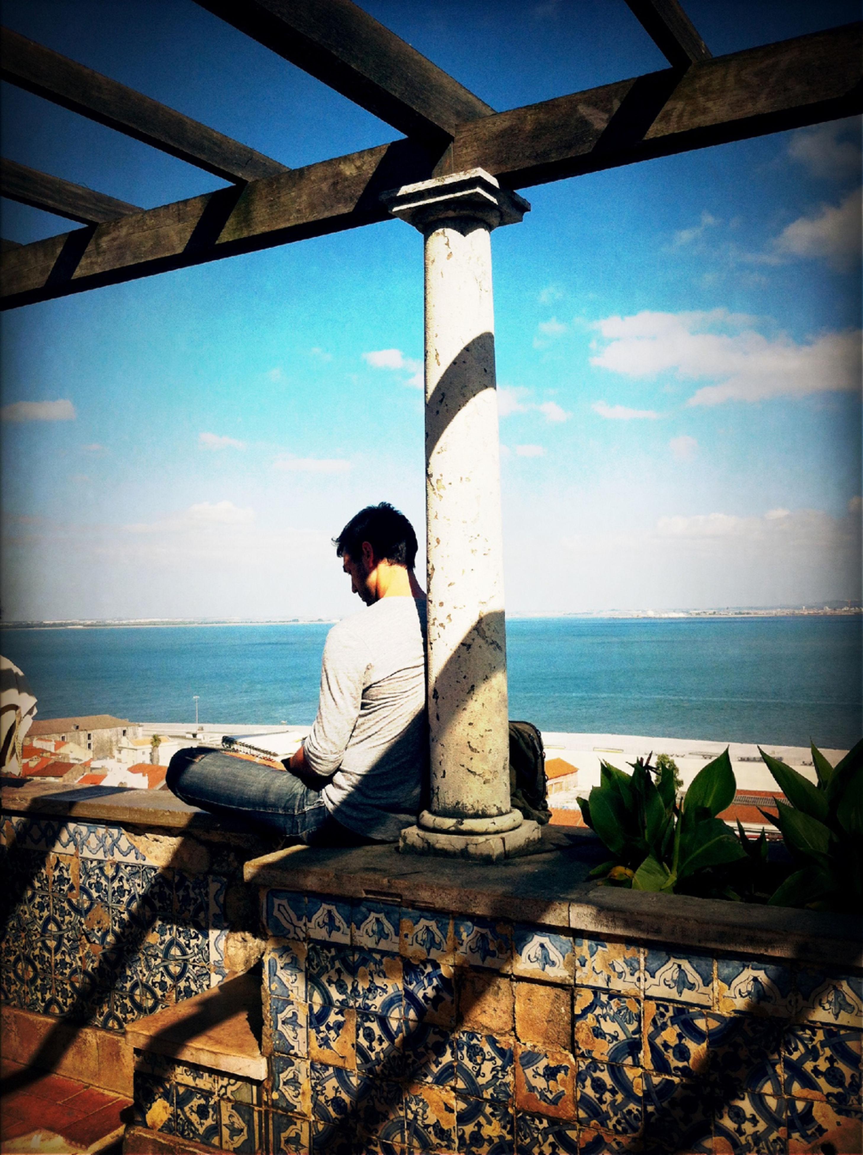 sea, horizon over water, sky, water, cloud - sky, cloud, tranquility, built structure, art, human representation, nature, tranquil scene, beach, art and craft, day, scenics, statue, sculpture, creativity, sunlight