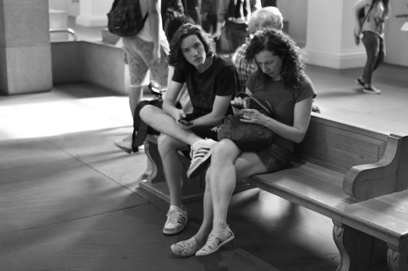 Bored tourists at the British Museum, No 2 Street Photography People Watching Tourists Museum Bored Sitting Phones Showcase July Black And White