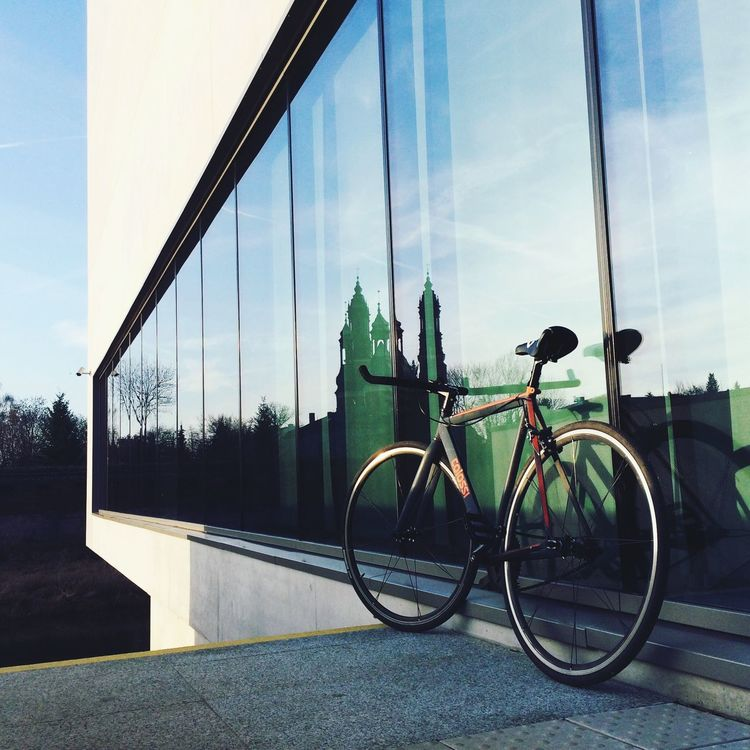 that's my Colossi bike in Poznan(Poland) with supernice architecture _[] riding it keep me positive everyday_~) Bike Life Colossi Arch Glass Reflection Bike Love Shimano Dura Ace Supernice Poznań First Eyeem Photo Celebrate Your Ride