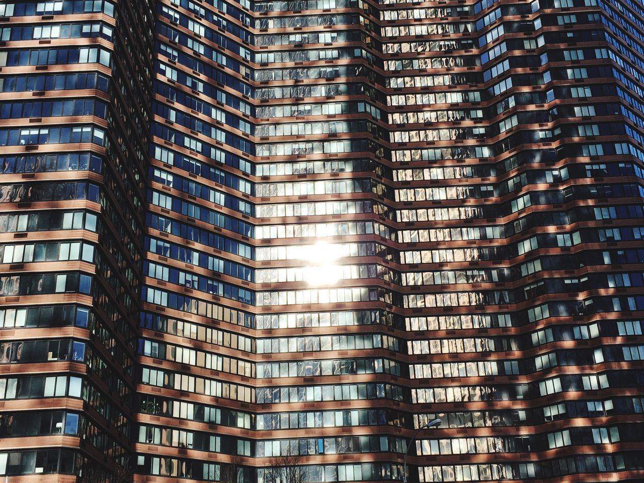 pattern Architecture City illuminated built structure Modern building exterior Low angle view no people skyscraper backgrounds outdoors day Finding New Frontiers NYC New York City windows sun Reflection The City Light