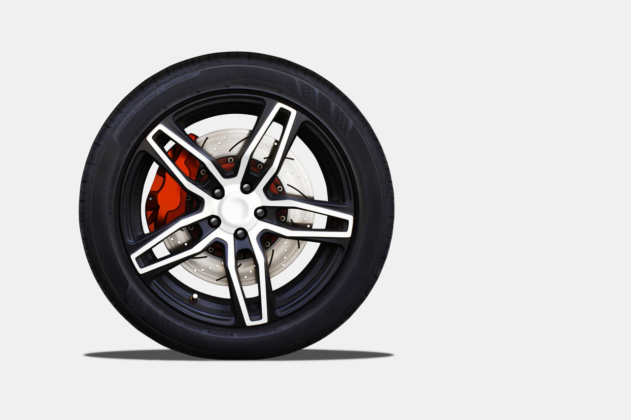Close up of a modern sport wheel with brake disk and caliper pad. isolated background and clipping path. Wheel Brake Disc Isolated Caliper Pad Clipping Path Modern Close Up Rim Racing Race Design Creative Luxury Decorative Service Circle Tyre Tire Black Alloy Wheels Speed Car Part Equipment