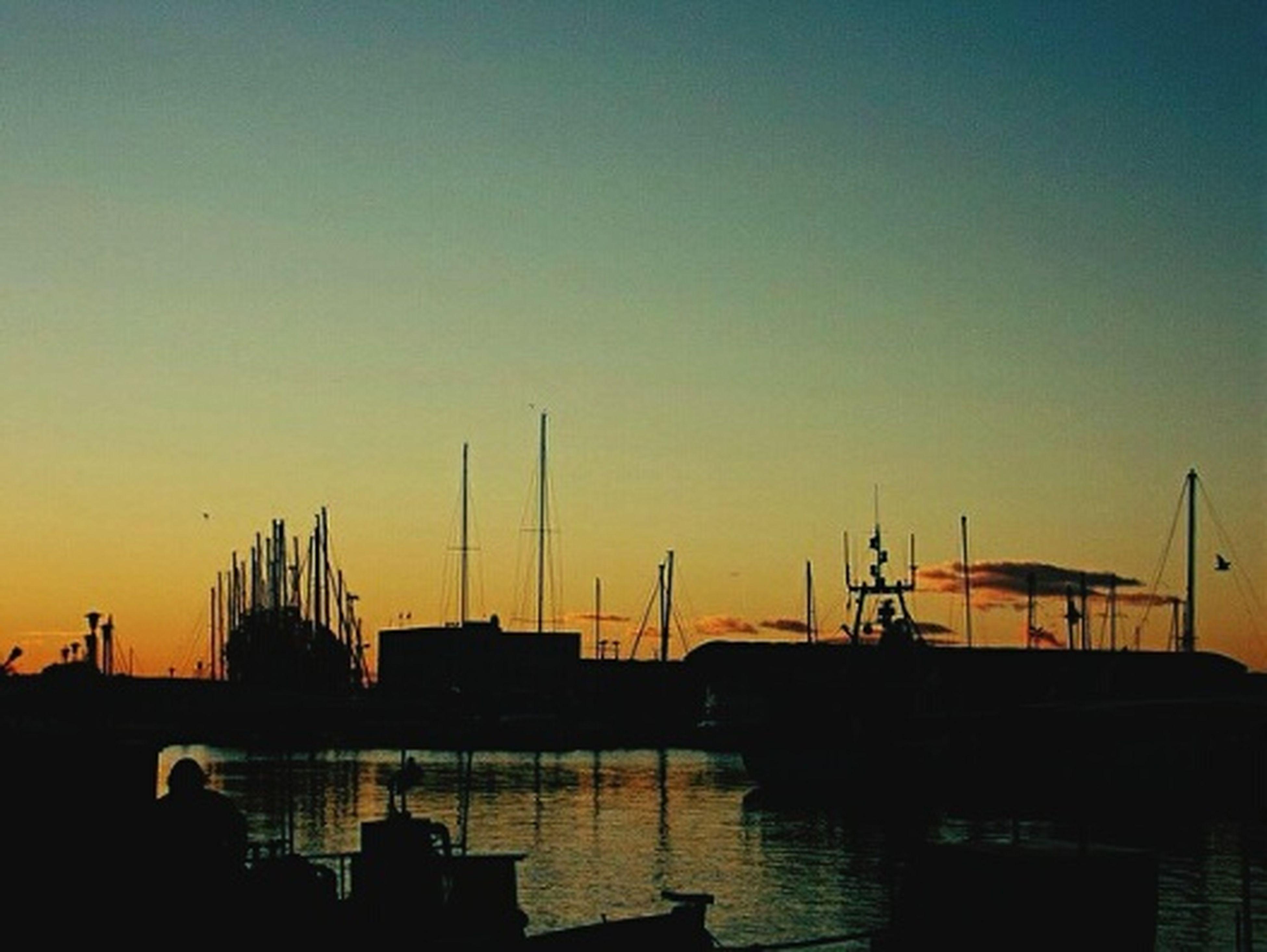 sunset, crane - construction machinery, harbor, crane, built structure, silhouette, architecture, building exterior, commercial dock, water, development, orange color, nautical vessel, industry, construction site, copy space, waterfront, clear sky, sky, construction