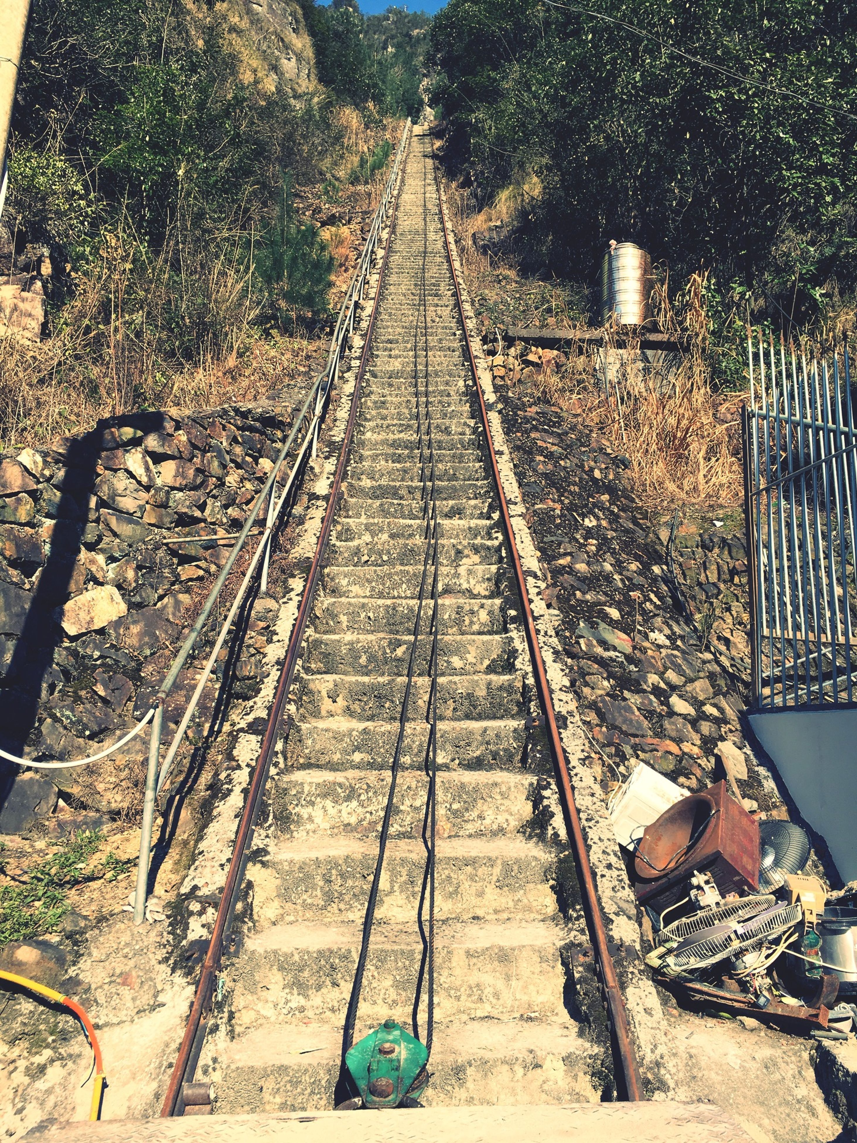 railroad track, transportation, the way forward, rail transportation, diminishing perspective, vanishing point, mode of transport, public transportation, railway track, high angle view, metal, travel, day, straight, no people, railroad station, empty, absence, railroad station platform, tree