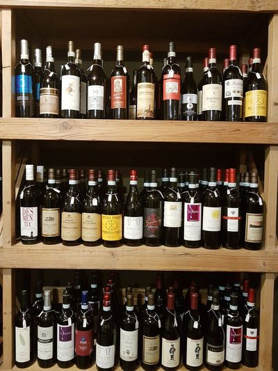 Bottle Shelf Drink Choice In A Row Wine Bottle Alcohol Variation Large Group Of Objects Liquor Store Order Abundance Indoors  Arrangement Food And Drink Wine Store Retail  No People Day Piedmont Wines Langhe Piedmont Italy Travel Destination