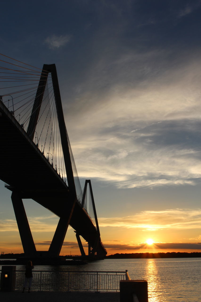 sunset, sky, water, cloud - sky, bridge - man made structure, orange color, connection, sea, silhouette, beauty in nature, built structure, nature, scenics, sun, suspension bridge, transportation, tranquility, no people, outdoors, architecture, travel destinations, horizon over water, day
