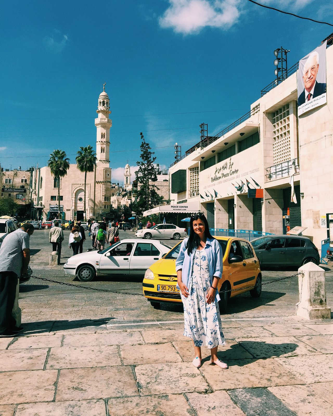 A tourist standing on the square in Bethleem, Palestine Arab Arabic Beautiful Bethlehem Cars Flag History Holy City Palestine Place Square Street Taxi Tourist