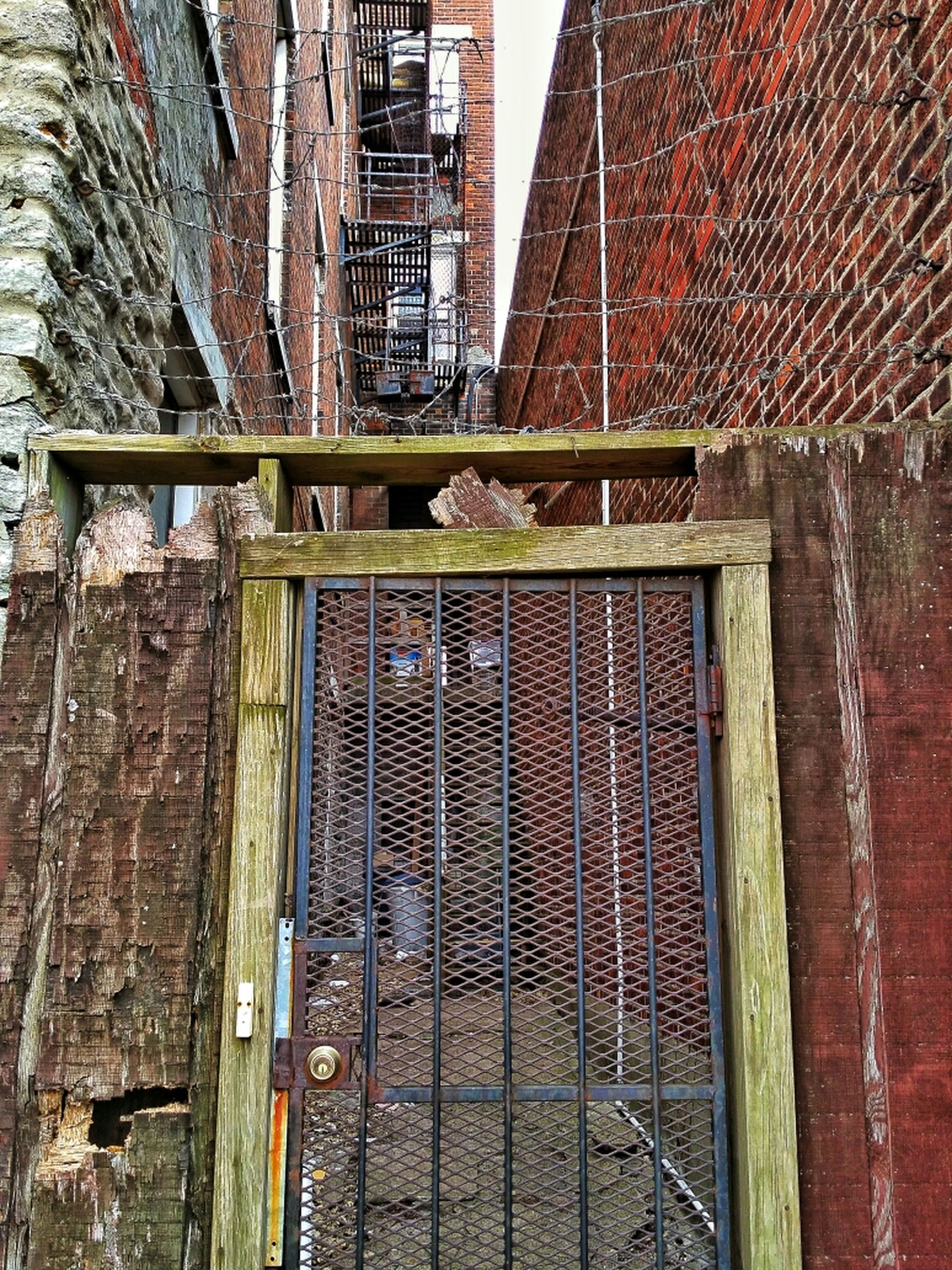 architecture, building exterior, built structure, brick wall, window, building, residential structure, house, door, wood - material, residential building, wall - building feature, old, weathered, city, closed, outdoors, day, safety, no people