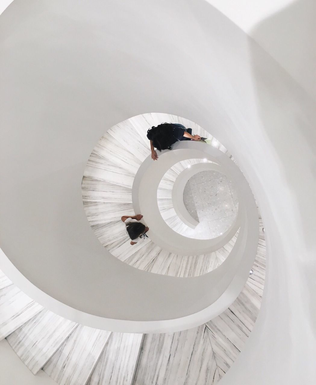 full length, indoors, high angle view, steps and staircases, young adult, one person, sitting, real people, day, architecture, young women, people