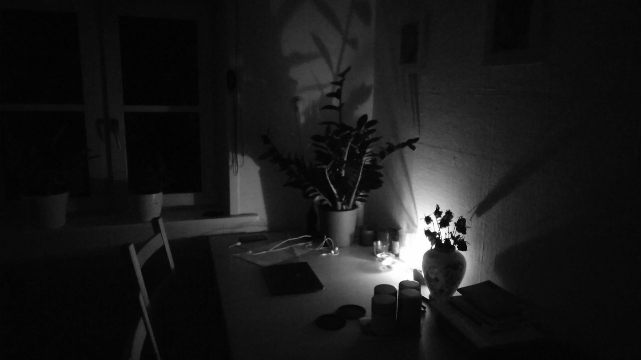 candlelight. · Hamburg germany Candle Candles Household apartment kitchentable work environment Workplace light and shadow Light Darkness Night Shot Night Photography black and white monochrome