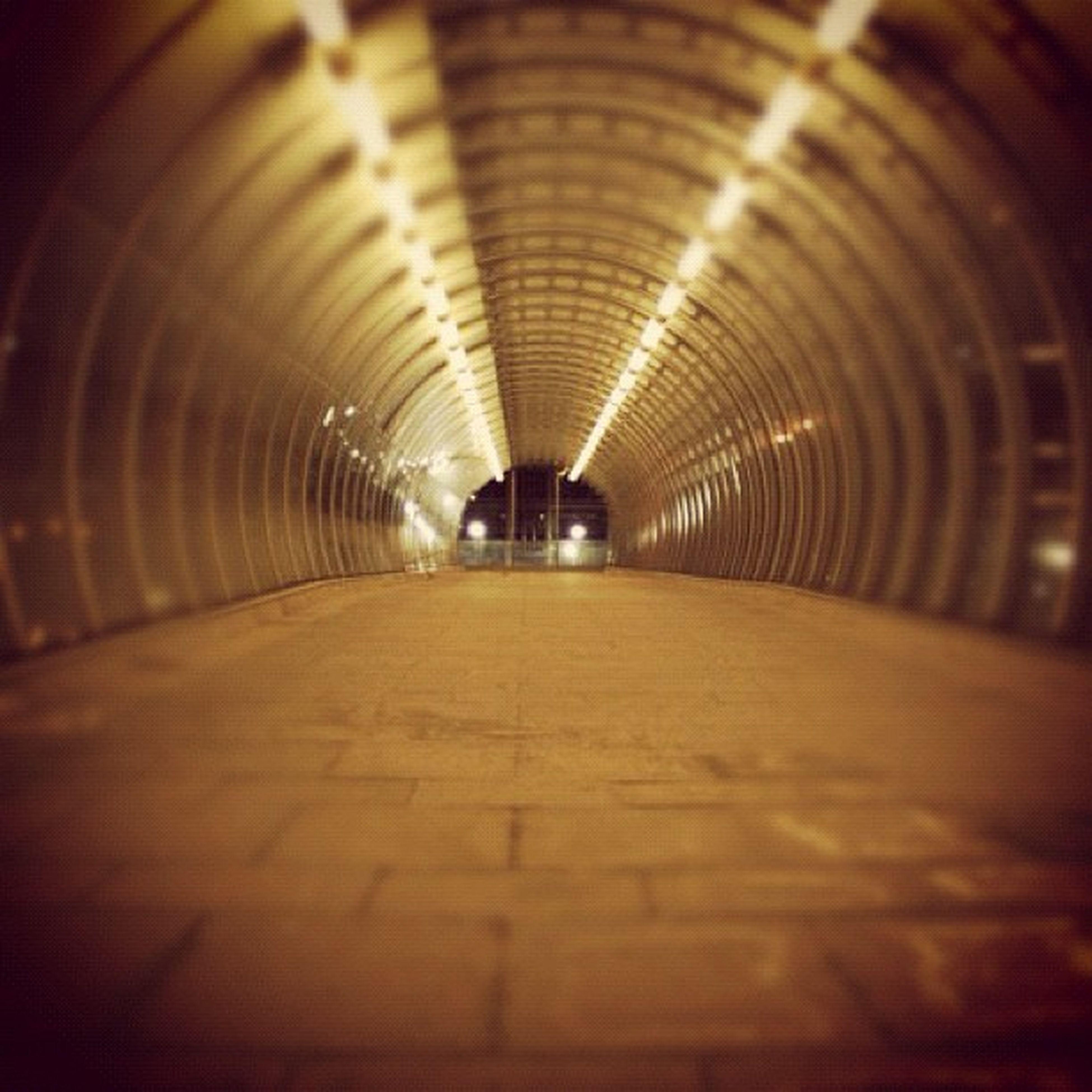 the way forward, indoors, illuminated, diminishing perspective, tunnel, vanishing point, lighting equipment, ceiling, empty, transportation, architecture, built structure, night, surface level, light - natural phenomenon, in a row, arch, electric light, corridor, long