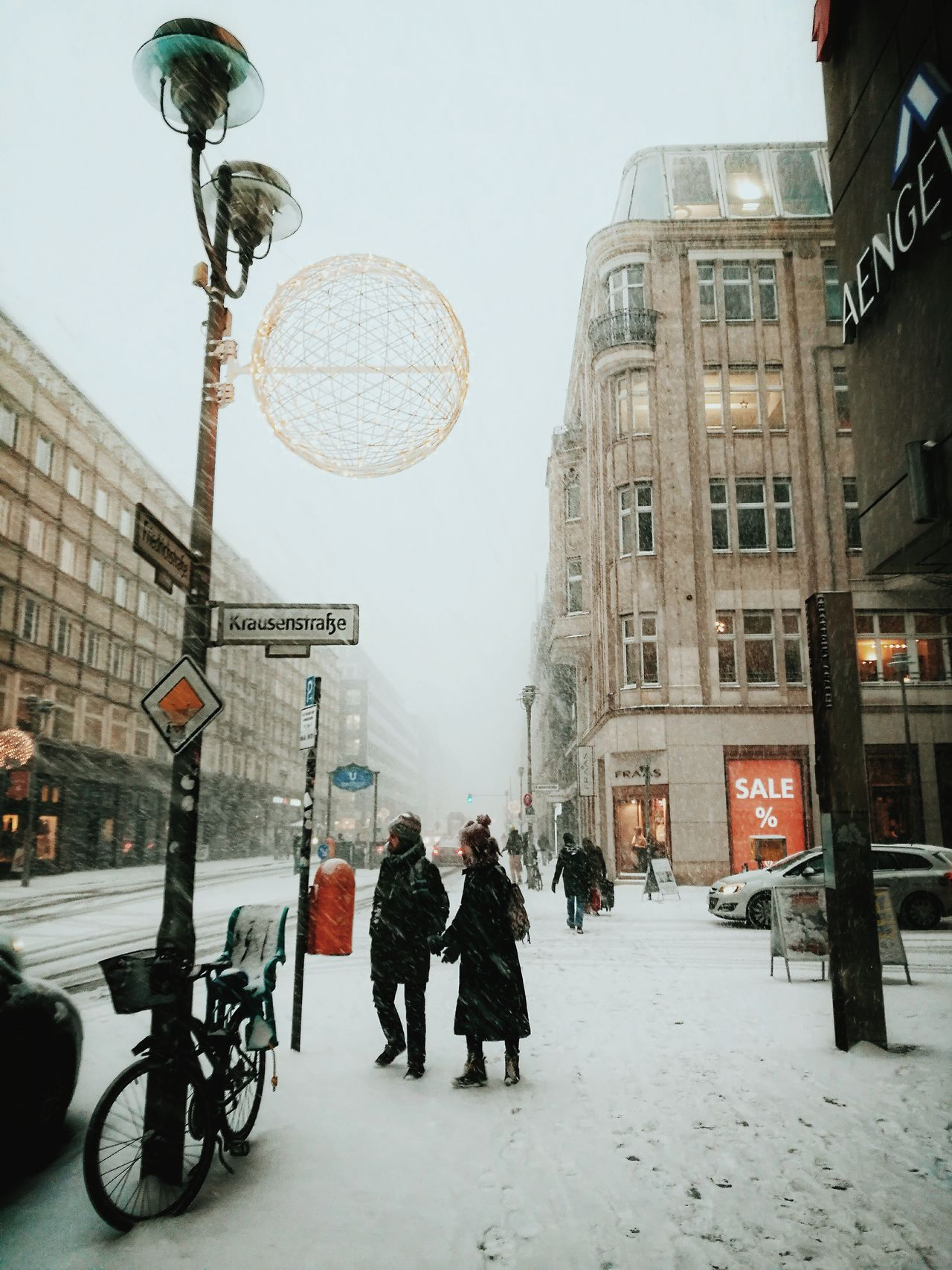 Snowcalypse in Berlin... City Outdoors Adults Only Snowing Huawei P9 Leica Streets Of Berlin Cold Temperature Huaweiphotography Crossing The Street Built Structure Streetphoto_color Streetscene Streetphotography Urban Lifestyle Togetherness Snow Real People Urban Winter Winter Wonderland