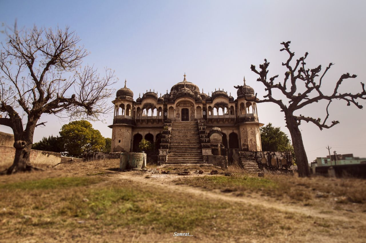 architecture, history, built structure, travel destinations, the past, tourism, religion, place of worship, spirituality, clear sky, travel, day, building exterior, outdoors, old ruin, no people, sky, bare tree, dome, ancient civilization, tree