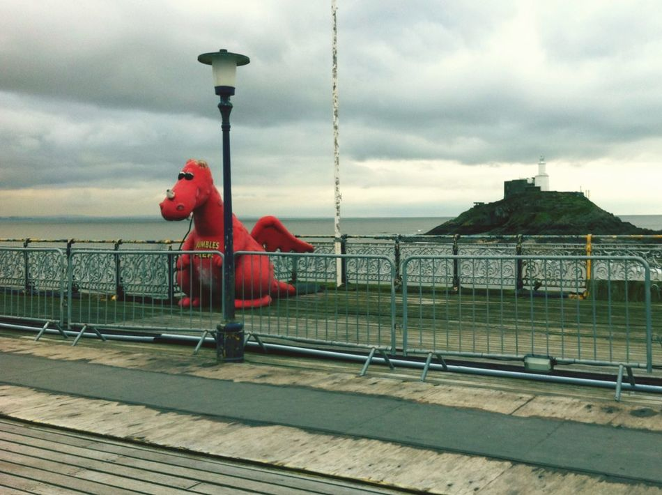 Stand Out From The Crowd Dragon Pier Sea Swansea The Mumbles Mumbles Lighthouse dragon on mumbles pier, swansea. First Eyeem Photo Ocean
