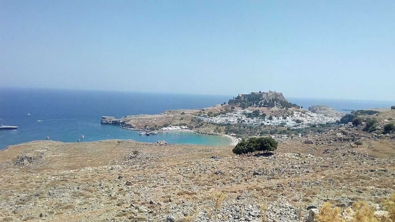 Wild Lindos-Rhodes from distance . Sea Sky Travel Destinations No Filter EyeEmNewHere Greece No Edit/no Filter No People Beach Tradition Rhodes Lindos Castle View  Traditional House Lindos Greece Greek Islands Aplacetosee Wilderness Rocky Coastline Rocky Terrain Scenic Landscapes Scenic View Summer Hot Day The Great Outdoors - 2017 EyeEm Awards Place Of Heart Sommergefühle The Week On EyeEm