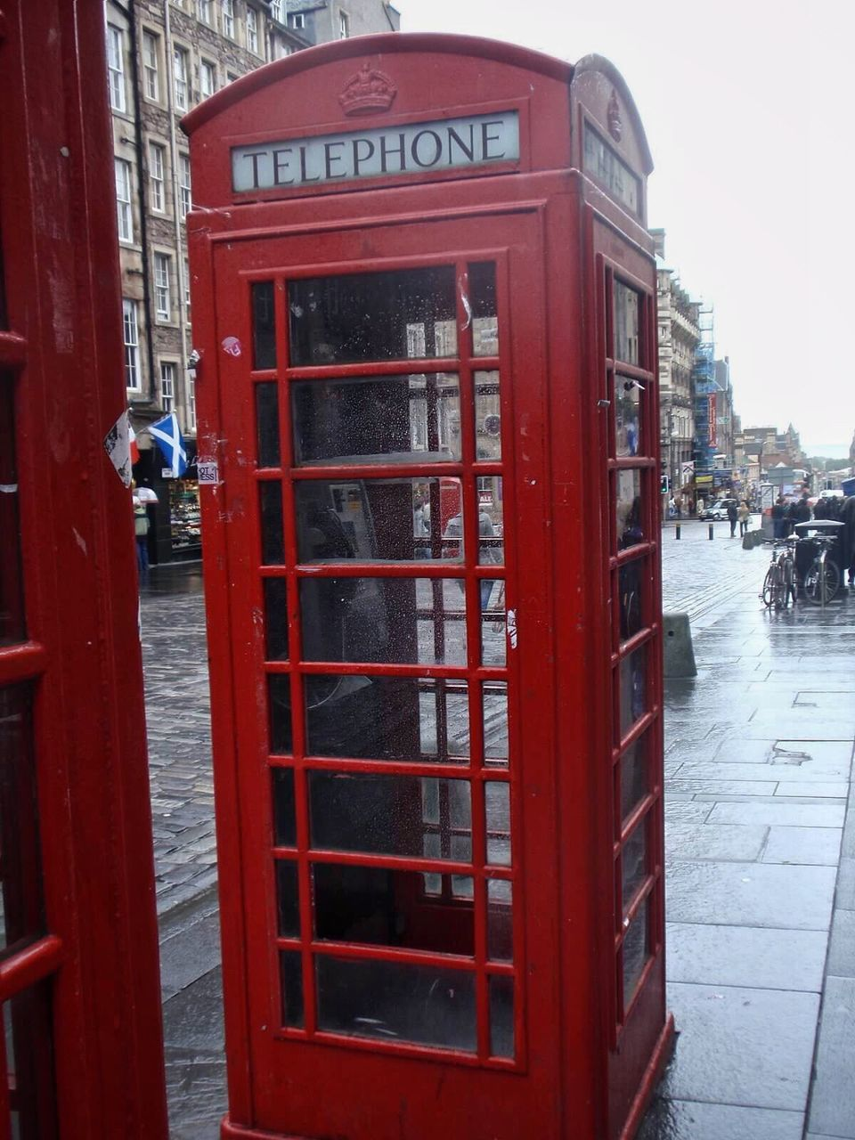 telephone booth, pay phone, communication, red, connection, telephone, day, built structure, street, outdoors, architecture, convenience, technology, building exterior, city, real people