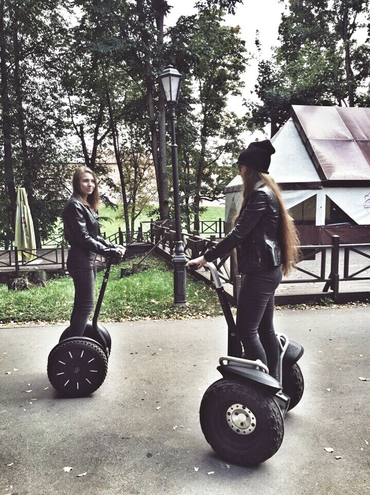 Full Length Tree Leisure Activity Lifestyles Casual Clothing Transportation Mode Of Transport Land Vehicle MotionVelikiy Novgorod Person Bicycle Riding Young Men Travel Sport Young Adult Balance Road City Confidence