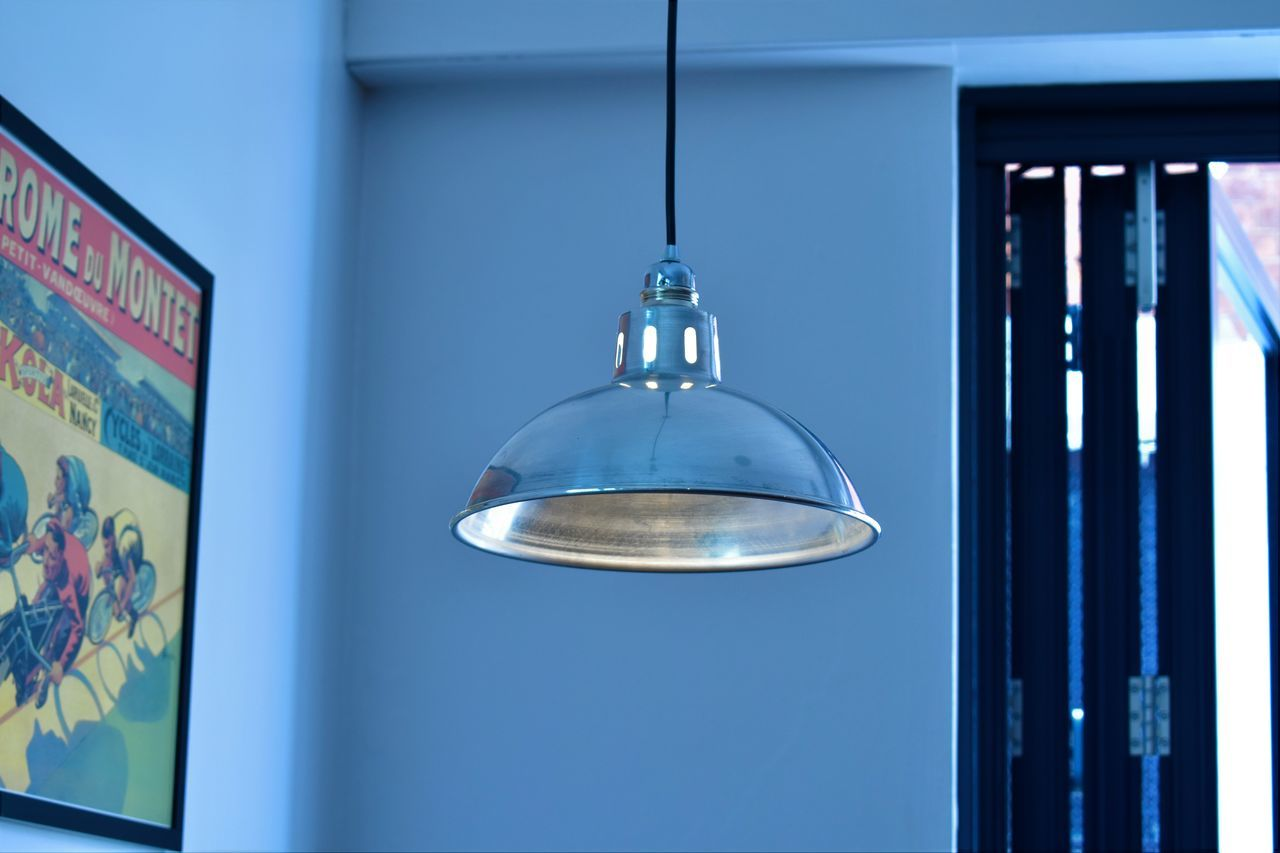 Pendant Light Hanging Against Wall