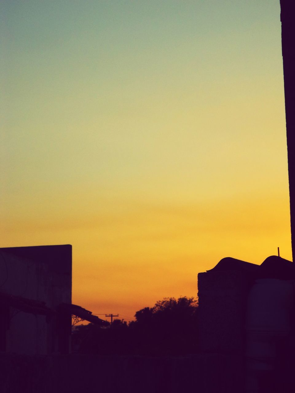 sunset, building exterior, silhouette, built structure, architecture, no people, sky, copy space, clear sky, outdoors, travel destinations, nature, city, beauty in nature, day