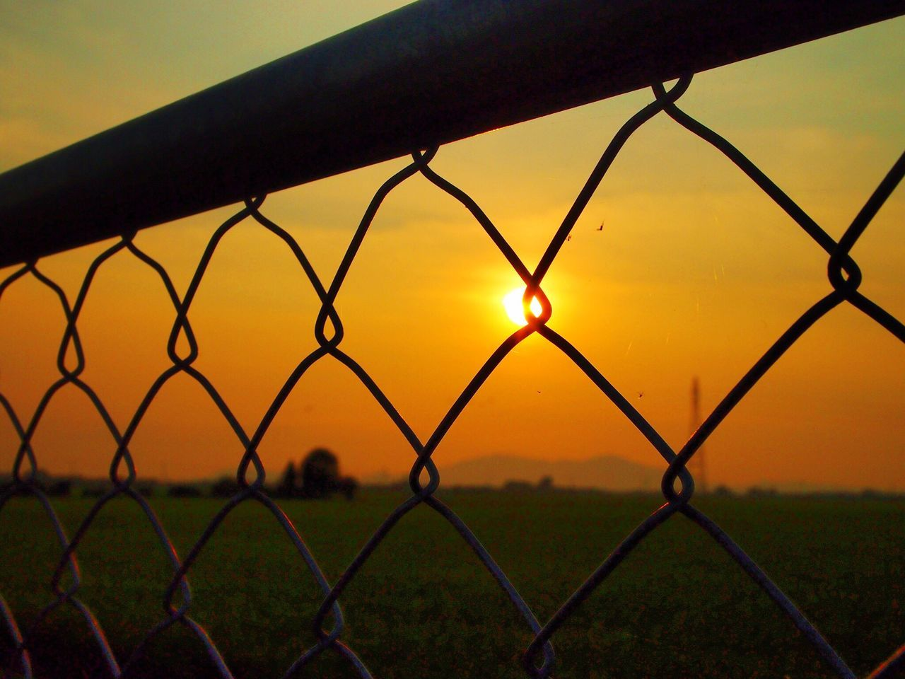 chainlink fence, sunset, security, safety, protection, metal, field, sky, outdoors, nature, no people, landscape, grass, focus on foreground, silhouette, scenics, beauty in nature, close-up, day