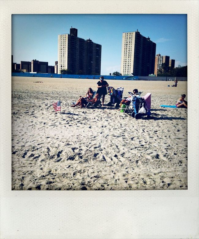 The Essence Of Summer Memorial Day At The Beach Beach Photography Beachphotography Buildings Check This Out City Life Cityscape Enjoing Life Enjoying The Sun Enjoyment Group Of People Hello World Lifestyles Outdoors People Photography Polaroid Polaroid Art Seaside Shore Simple Things In Life Staring At The Sun Tourist Vacations