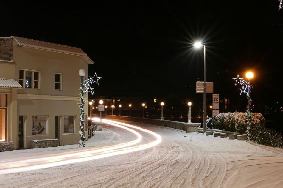 Photography In Motion Streaking Light Motion Driving Transportation Snowy Street Calming No People Night Lights Lake Chelan Bridge Buildings Nightlights Quiet Envision The Future Adapted To The City