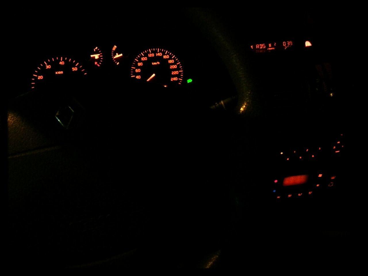 vehicle interior, car interior, night, illuminated, car, speedometer, mode of transport, transportation, dashboard, control panel, land vehicle, dark, gauge, men, two people, real people, indoors, people