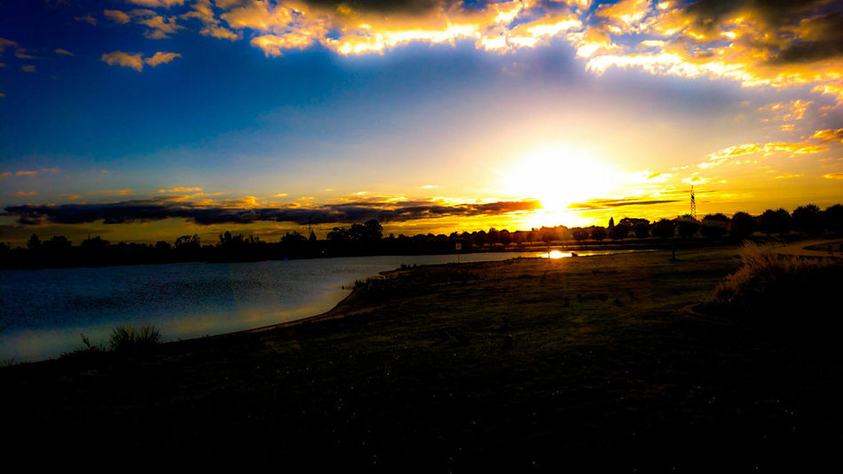 Sunset Tranquil Scene Sun Tranquility Scenics Lake Water Beauty In Nature Sky Landscape Cloud Nature Idyllic Cloud - Sky Calm Orange Color Outdoors Non-urban Scene Moody Sky Solitude Hanging Out Eeyem Photography Nature Photography Beauty In Nature Showcase October 2016