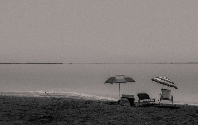 Grainy Day Dead Sea Israel Beach Beauty In Nature Black & White Black And White Blackandwhite Blackandwhite Photography Dead Sea  Deadsea EyeEm Team Film Getty Images Grain Grainy Images Horizon Over Water Monochrome Photography Protection Remote Sea Seascape Sunshade Umbrella Vacations