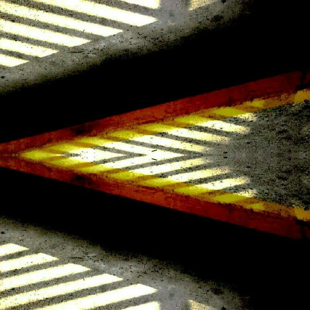 striped, yellow, textured, multi colored, no people, paint, black color, day, road, backgrounds, outdoors, line, close-up