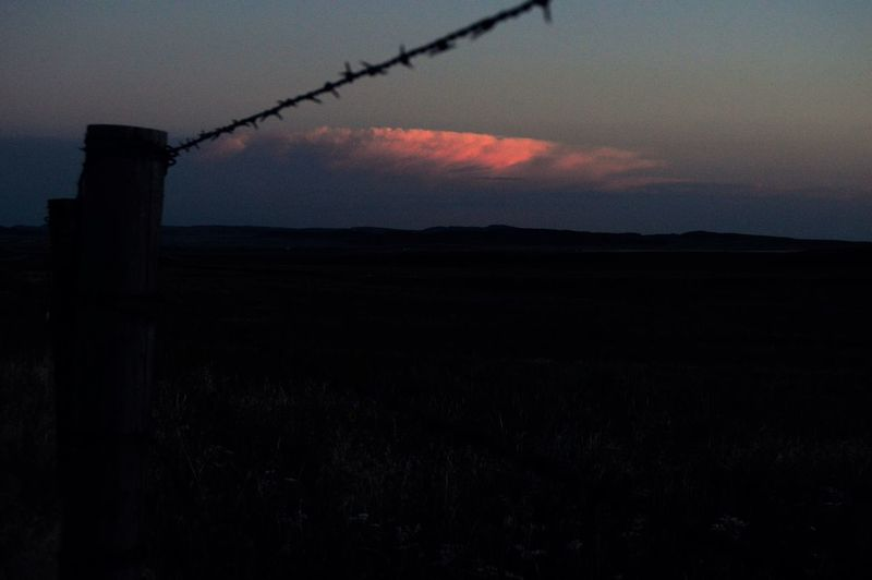 Building of the thunderstorm Beautiful Colors Beauty In Nature Darkness Setting In Fence In Foreground Clos Up Rural Scene Sun Glowing Off The Clouds Sun Goin Down Fast Tranquil Scene
