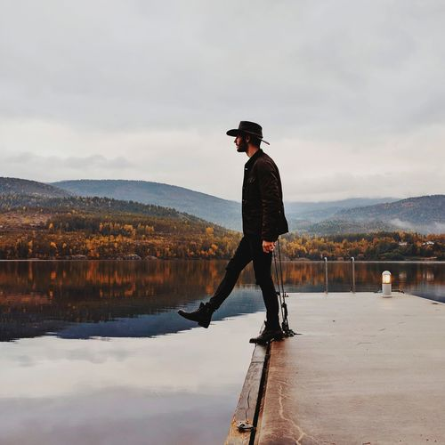 EyeEm Selects Reflection One Man Only Cloud - Sky Standing One Person Only Men Full Length Adult Lake Mature Men One Mature Man Only Adults Only Water Men People Mature Adult Sky Mountain Day Outdoors Mountains Lake View Steps Norway