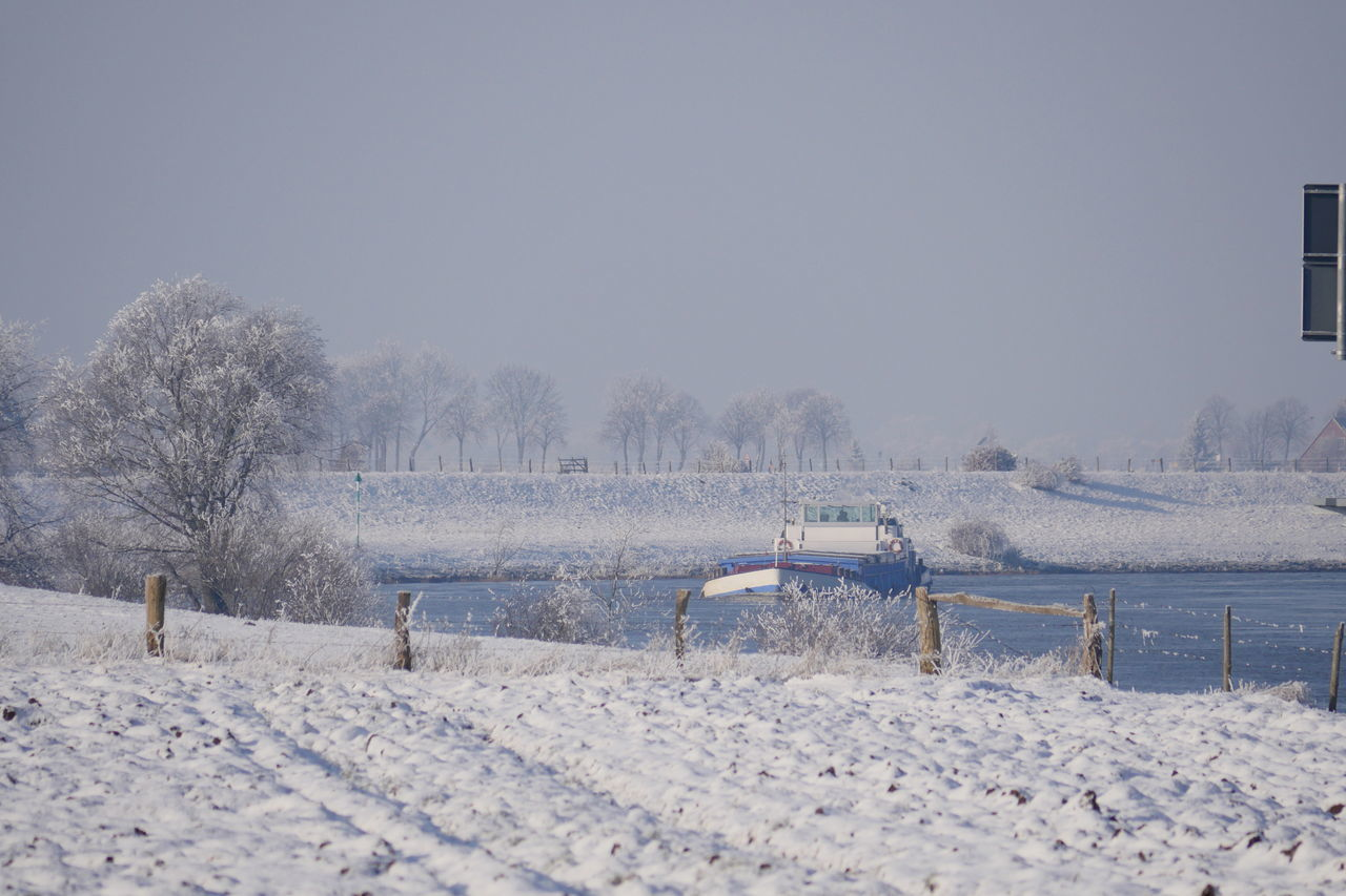 Cold Temperature Day Freight Transportation Inland Waterway Shipping Landscape Landscapes Mode Of Transport Nature Outdoors River River View Ship Sky Snow Snowy Taking Photos Transportation Waterway Winter From My Point Of View Perspective Frozen Nature Beauty In Nature