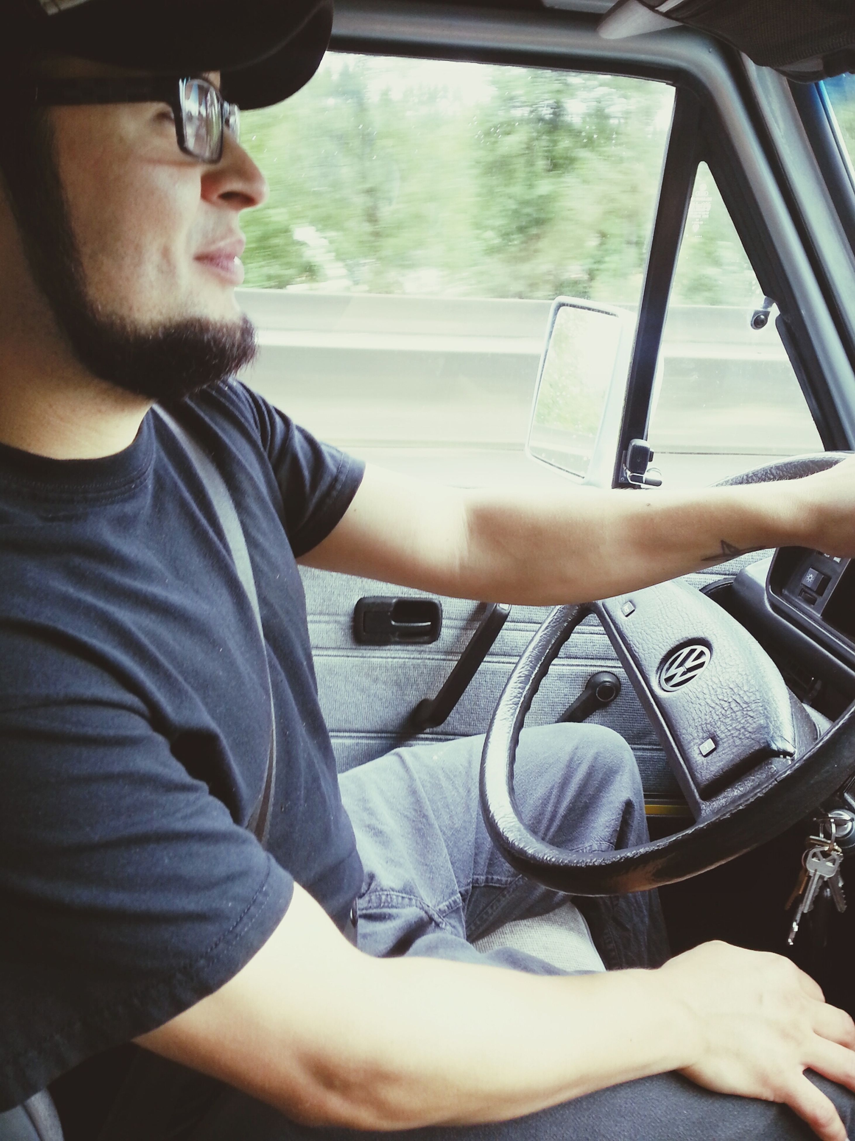 young adult, lifestyles, person, mode of transport, transportation, leisure activity, vehicle interior, young men, casual clothing, sitting, travel, land vehicle, portrait, car, sunglasses, looking at camera, water
