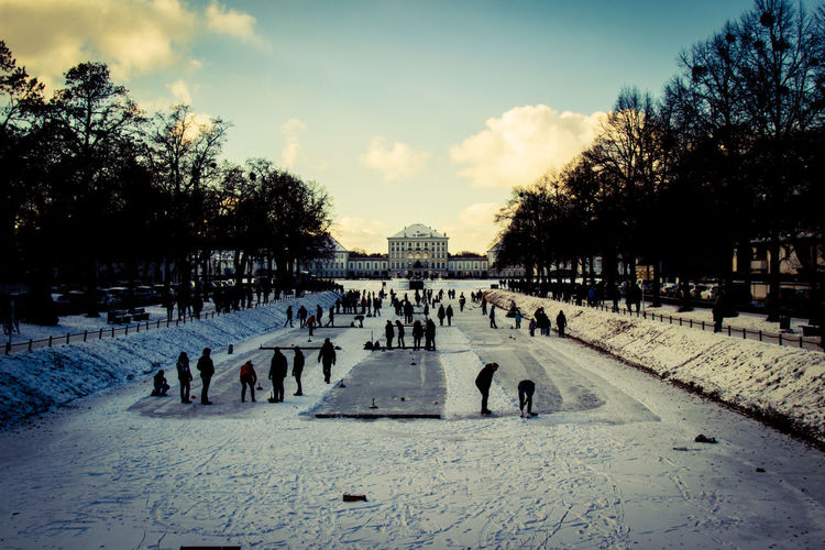 Ice Large Group Of People Nymphenburg Nymphenburg Palace Nymphenburger Kanal People People Having Fun Real People Silhouette Snow Snow ❄ Water Winter Dramatic Sky HDR High Dynamic Range Adapted To The City Shades Of Winter