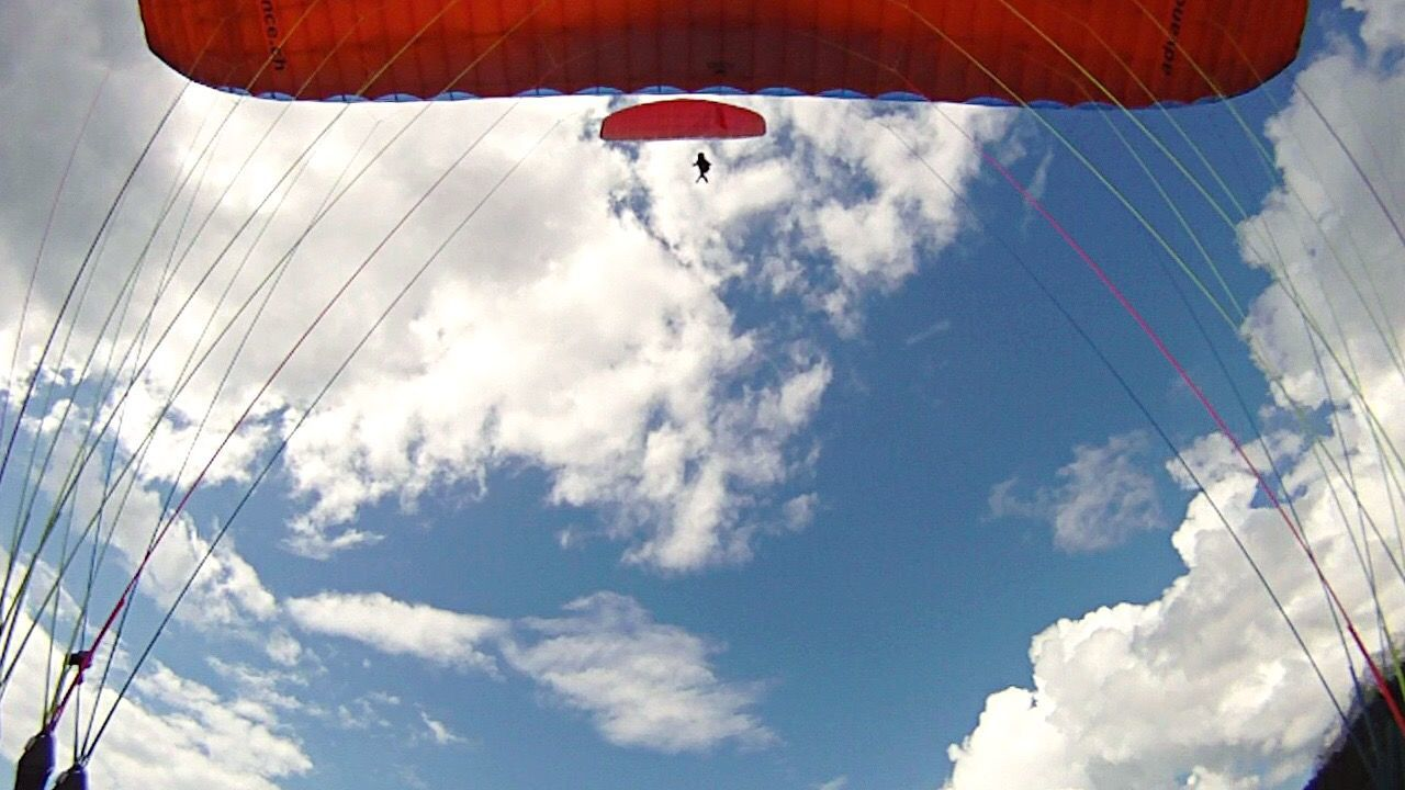 low angle view, sky, cloud - sky, day, outdoors, parachute, flying, adventure, no people
