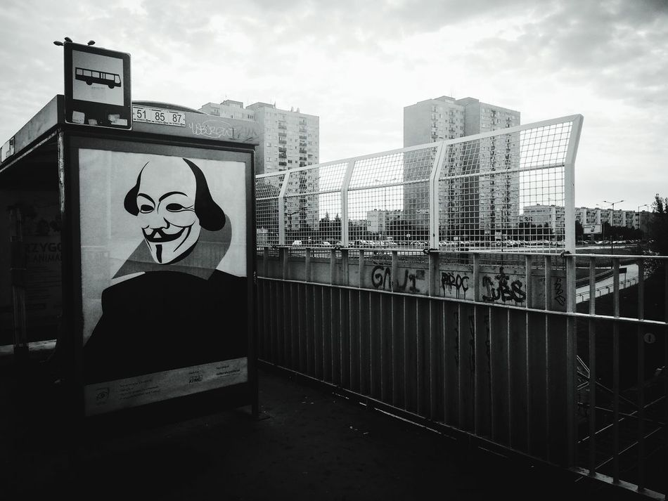City Built Structure Building Exterior Art Railing Creativity Cloud - Sky Sky Cloud Outdoors Cloudy City Life No People Modern Street Photography Street Anonimous Graffiti Shekspeare Shekspear Bus Stop Black And White Photography Poster Poster Art