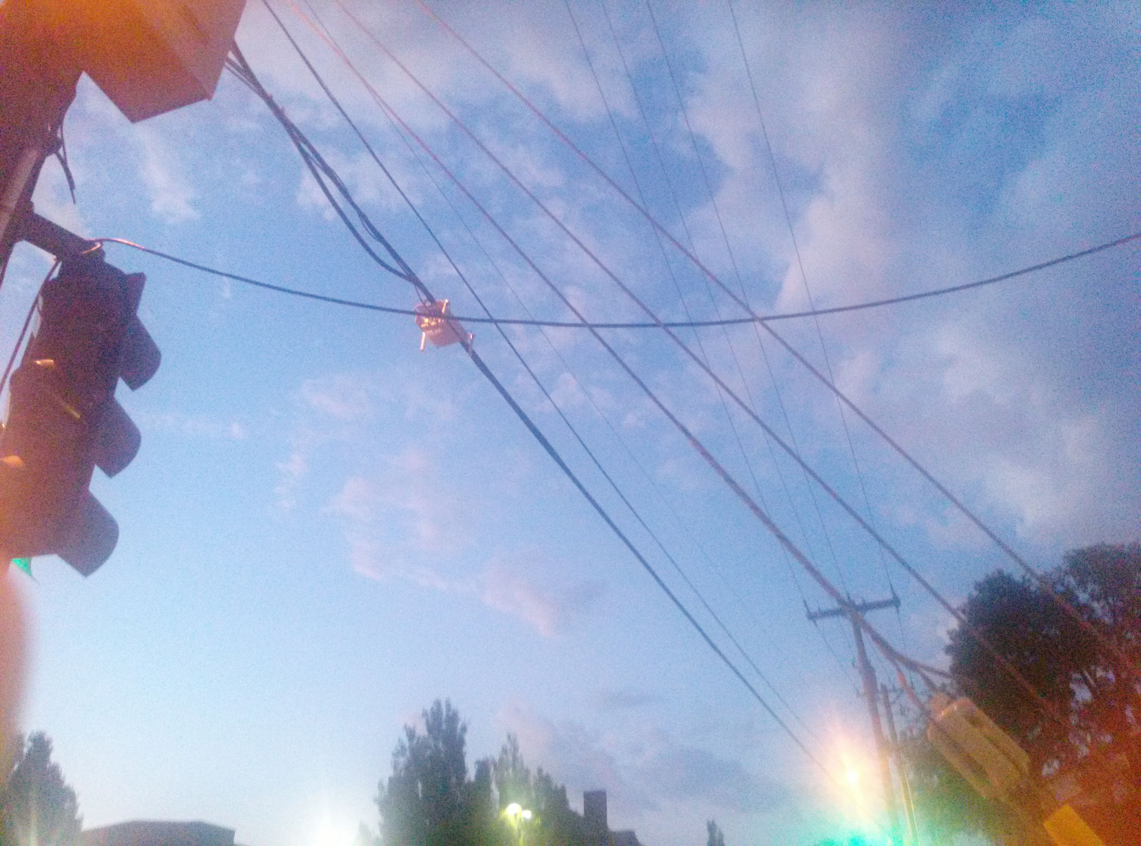 low angle view, sky, power line, cloud - sky, cable, electricity, electricity pylon, silhouette, connection, power supply, outdoors, cloud, cloudy, nature, sunlight, street light, sun, sunbeam, blue, day