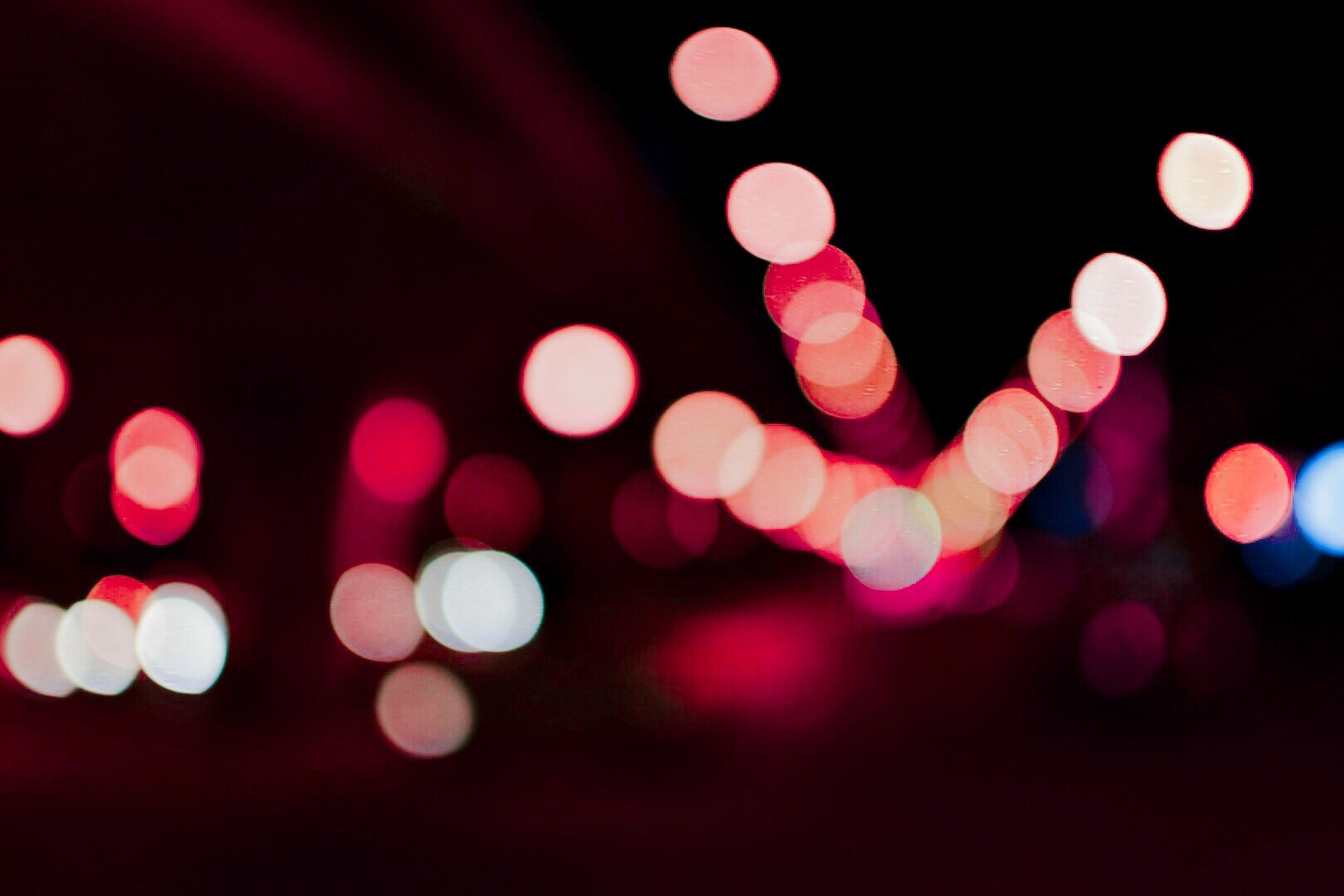 defocused, illuminated, circle, lighting equipment, night, abstract, multi colored, lens flare, light - natural phenomenon, pattern, glowing, spotted, ideas, blurred motion, city, outdoors, light, geometric shape, electric light, city life, dark, pink color, sky, nightlife, no people, bright, colorful, fairy lights