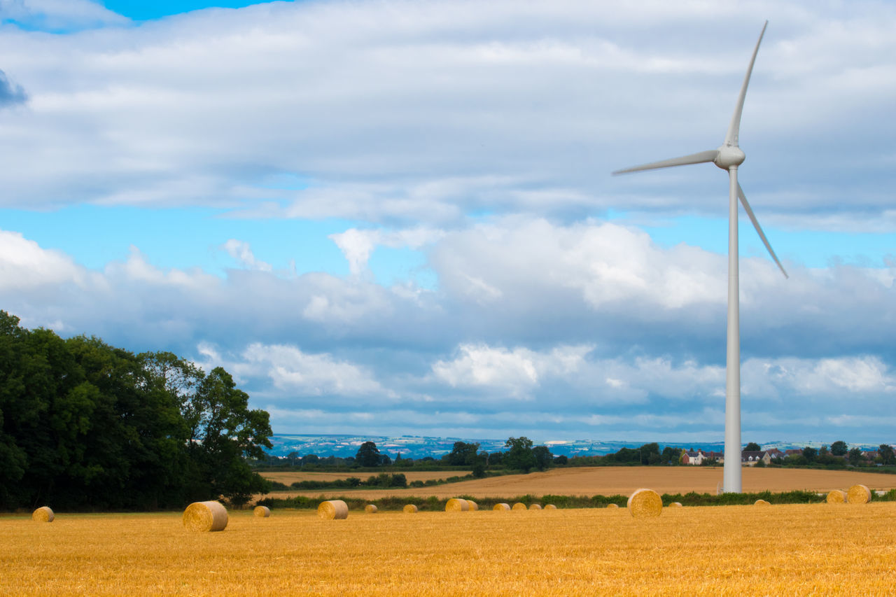 wind turbine, wind power, environmental conservation, field, alternative energy, renewable energy, windmill, rural scene, cloud - sky, fuel and power generation, bale, agriculture, sky, nature, landscape, day, no people, beauty in nature, tranquility, grass, outdoors, industrial windmill, scenics, tree, hay bale