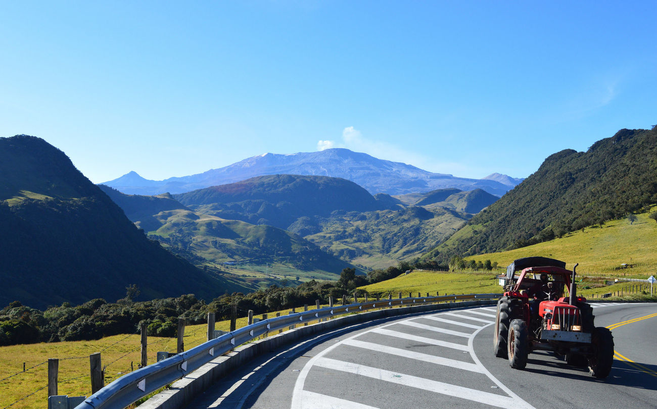 Volcán nevado Del Ruiz , Colombia Mountain Volcanic Landscape Volcano Nevado Snow Snowcapped Mountain Mountain Peak Vulcano Majestic Old Tractor Beutiful Day Colombia Caldas Tolima Manizales Road Cloud - Sky Landscape Green Color Travel Destinations Tranquility Panoramic ColombianPhoto Nature Sky