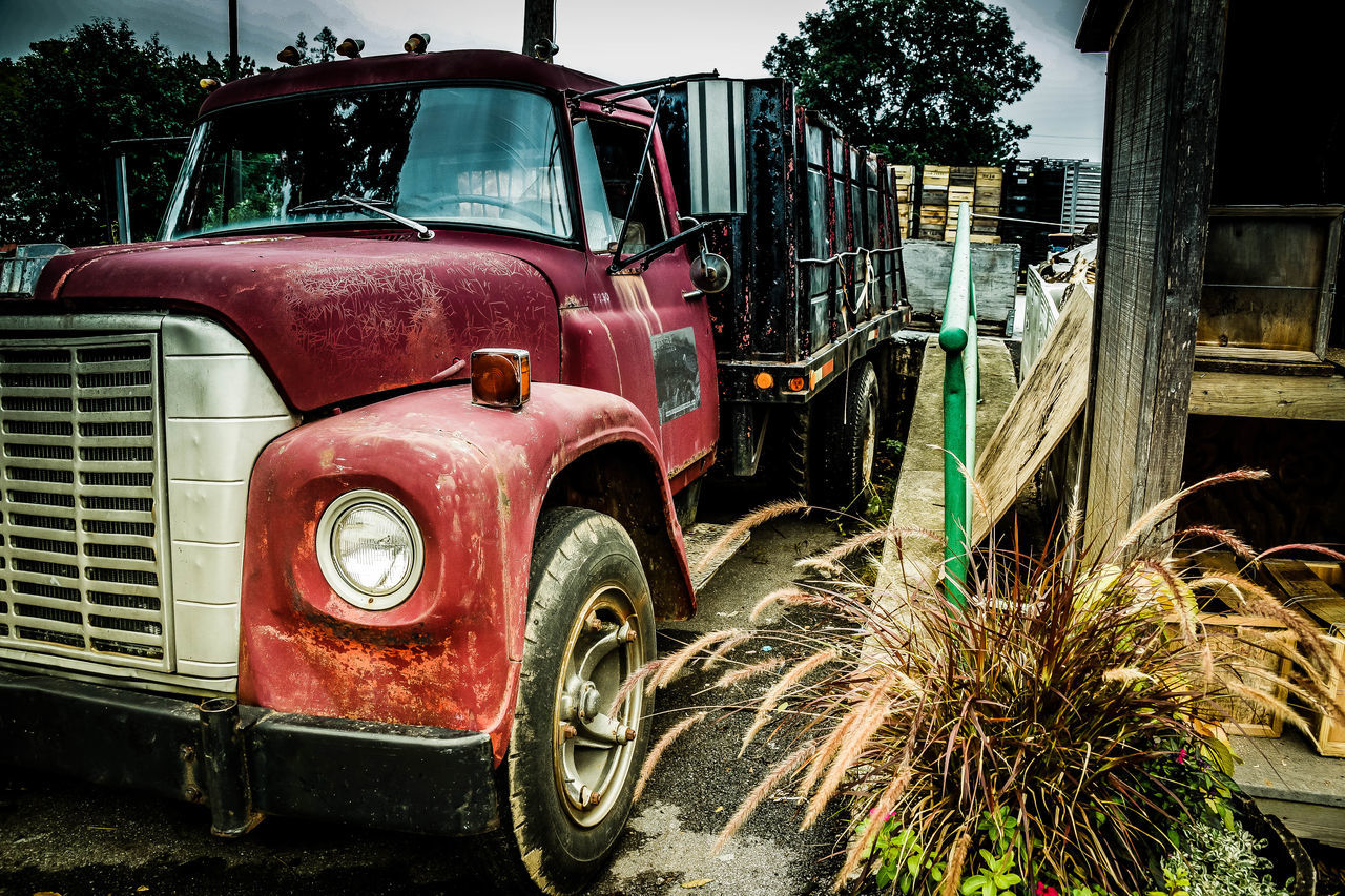 land vehicle, mode of transport, transportation, old-fashioned, stationary, retro styled, outdoors, red, no people, day