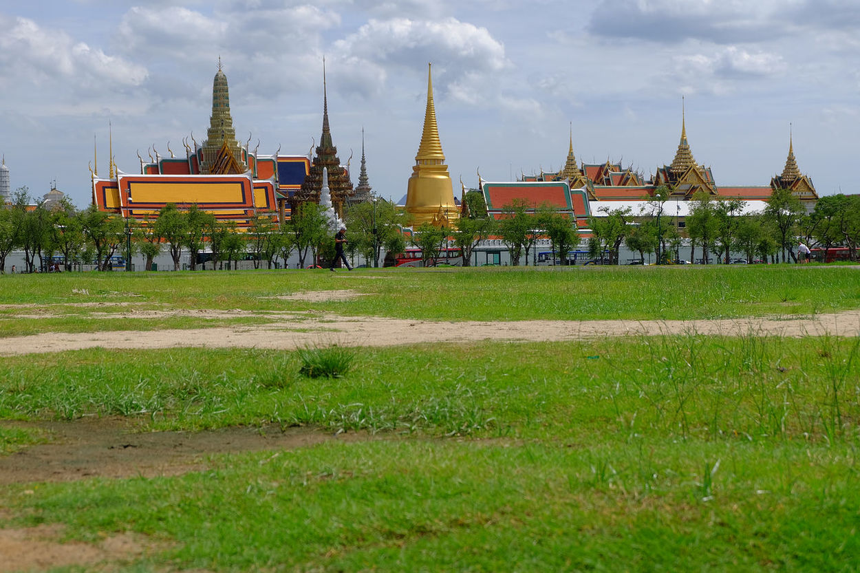 Sanam Luang landmark of Thailand Architecture Built Structure Cloud Cloud - Sky Cloudy Day Field Grand Palace Grass Landmark Landscape Lawn Outdoors Place Of Worship Plant Royal Plaza Sanam Luang Sanam Luang Bangkok Sky Sward Temple Temple Of Royal The Pramane Ground Wat Phra Kaew