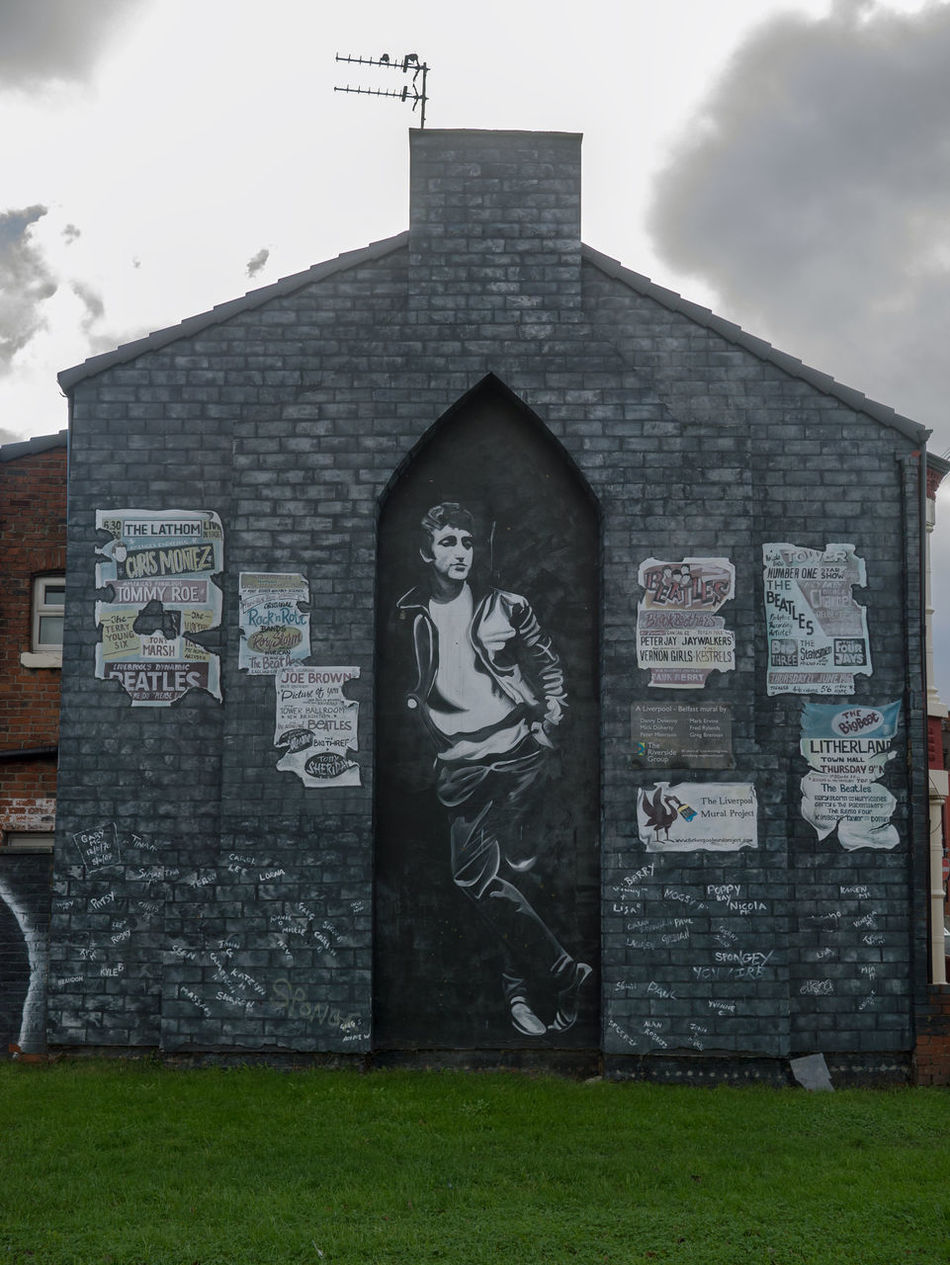 Part of the Beatles mural in Litherland, Liverpool. The whole side of the house is the mural, including the brickwork Beatles Bricks Building Exterior Community Art House John Lennon Litherland Mural Music Musician Painting Posters Wall