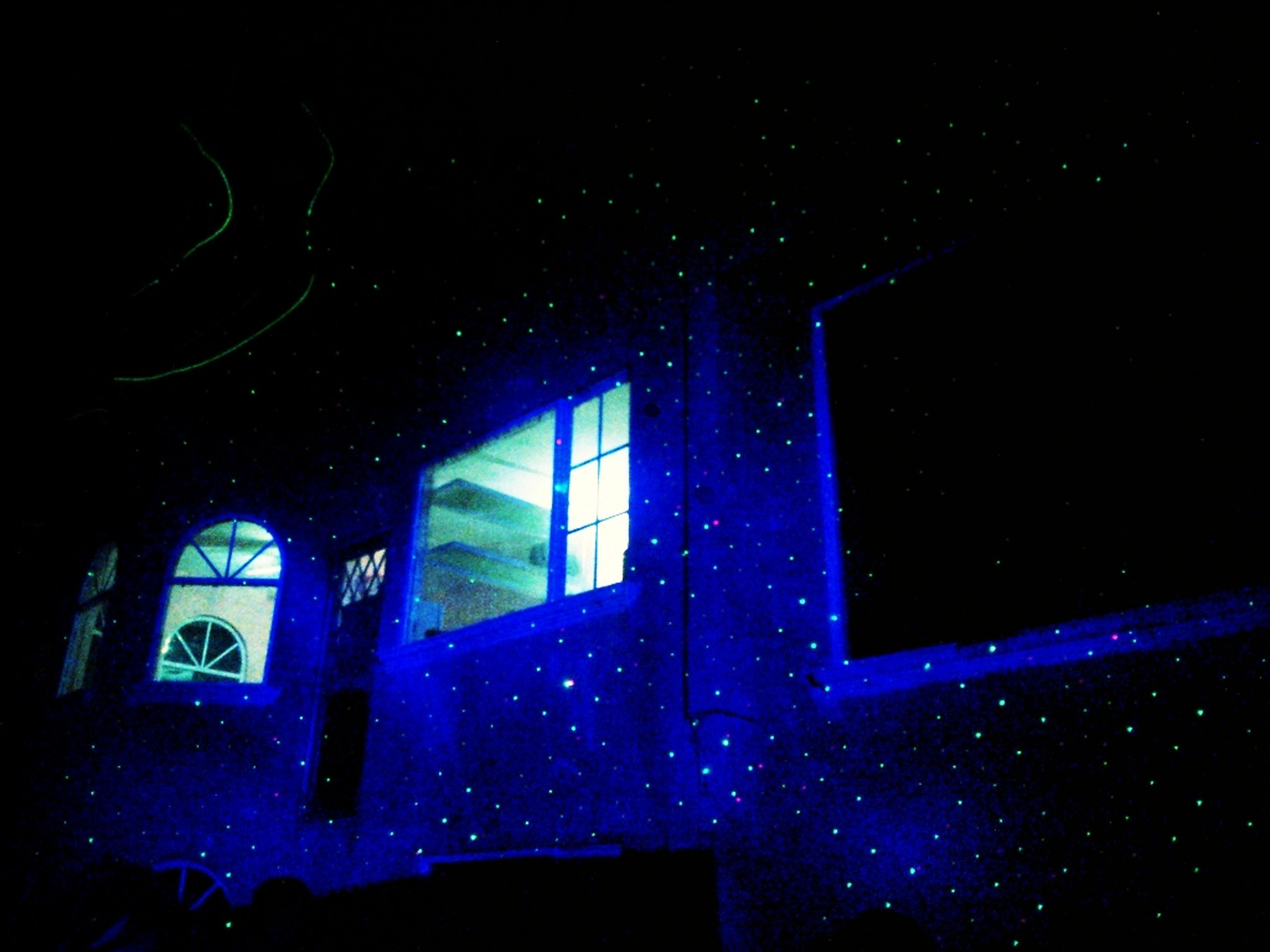 night, window, indoors, dark, illuminated, glass - material, low angle view, blue, transparent, no people, full frame, built structure, light - natural phenomenon, sky, backgrounds, close-up, star - space, glass, house, architecture
