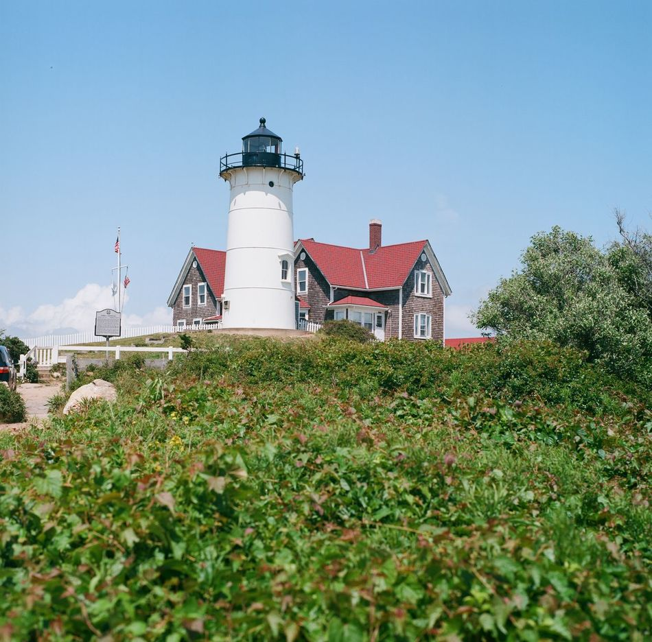 Architecture Blue Blue Sky Building Exterior Built Structure Cape Cod Clear Sky Day Green Lighthouse Massachusetts Nature New England  No People Plant